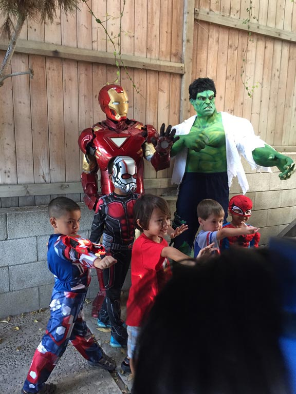 hulk and iron man with kids at birthday party