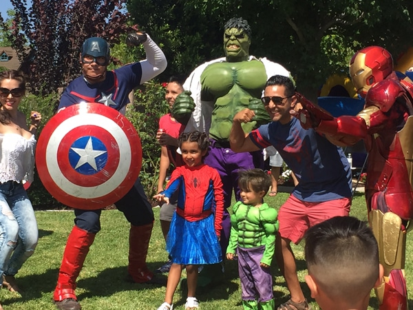 avengers captain america hulk and iron man pose for pictures with kids at a birthday party