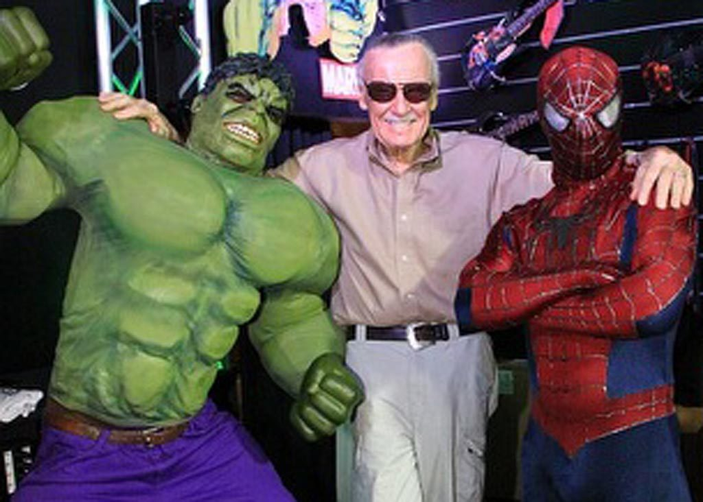 marvel's stan lee poses with hero's hulk and spider man